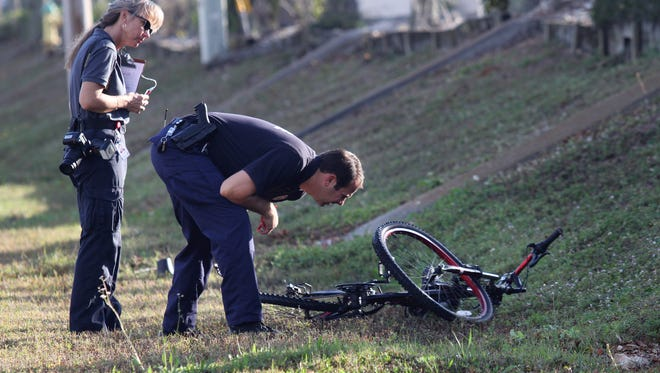 Cape Coral Police officers investigate the scene of a fatal hit-and-run crash in February. 2015.