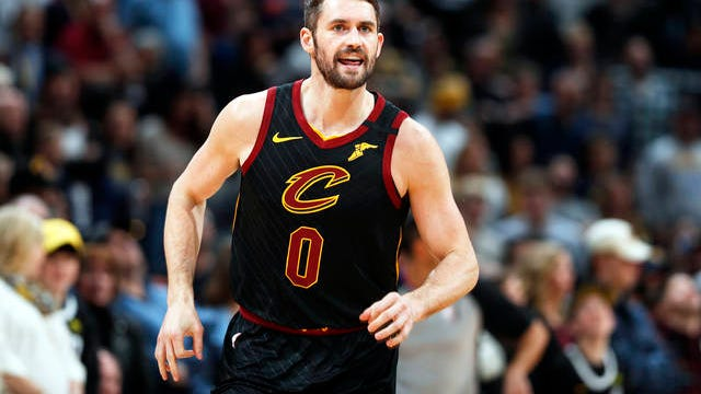 In this Jan. 11 file photo, Cleveland Cavaliers forward Kevin Love heads up the court after making a 3-point basket against the Denver Nuggets during the first half of an NBA basketball game in Denver. Love received the Arthur Ashe Award for Courage at the ESPY Awards on Sunday for sparking a national conversation about mental health.