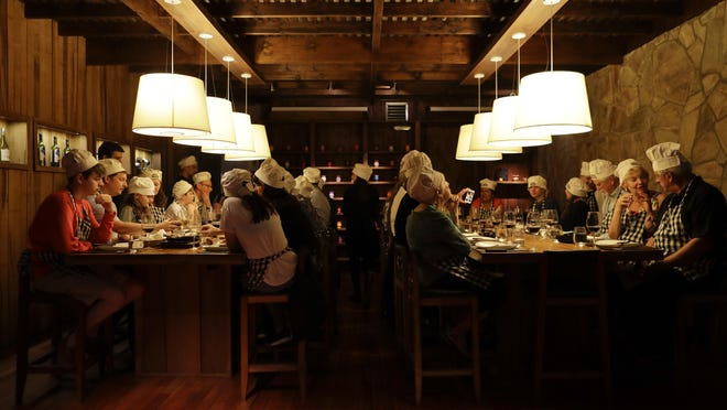 Diners at The Argentine Experience in Buenos Aires, Argentina, learn about the local cuisine, wine and traditions.