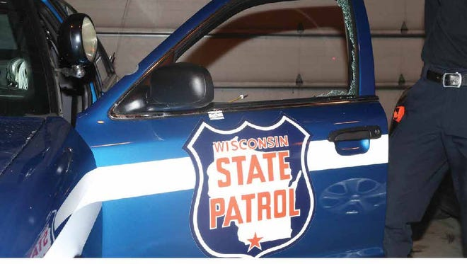 The shot out window of a Wisconsin State Patrol vehicle.