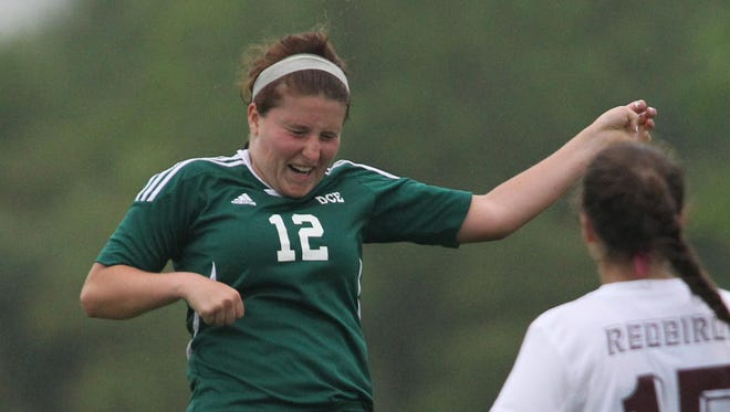 D.C. Everest's MacKenzie Corallo heads the ball during the WIAA Division 1 sectional final against De Pere last Saturday. Corallo is one of nine seniors on the Evergreens squad.