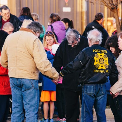 Attendees of a vigil in the days after the Kalamazoo