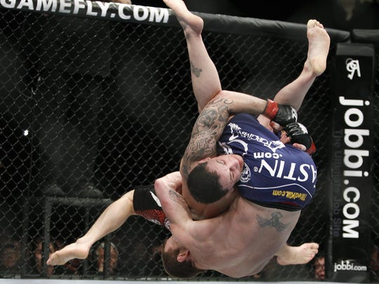Frankie Edgar takes down Gray Maynard during the second round of their UFC 125 split draw.