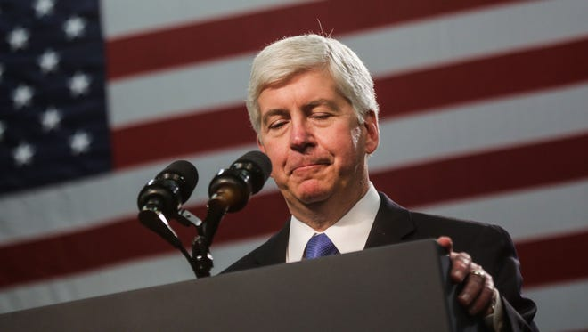 Governor Rick Snyder faces a crowd booing him during remarks to a crowd at Flint Northwestern High School on Wednesday May 4, 2016 before President Barack Obama speaks with those affected during the Flint Water Crisis.