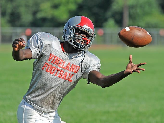 The Vineland football team had their 1st offical practice on Monday.  Vineland receiver Jeremiah Atoki catches a pass during practice.   Aug. 11, 2014.  Staff photo/Craig Matthews