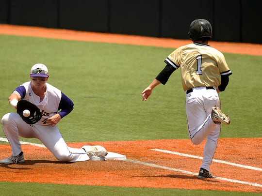 Wylie first baseman Bryce Gist (49) gets out Texarkana Pleasant Grove baserunner Joe Pearlman (1) during the top of the third inning of the Bulldogs' 7-5 win in the Class 4A state semifinal baseball game on Wednesday, June 8, 2016, at Disch-Falk Filed in Austin.