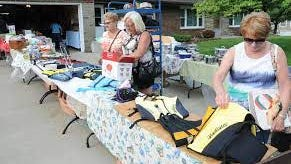 A trio of sisters attended a National Road Yard Sale near Old Washington a year ago. The sale for 2020 has been rescheduled to Aug. 19-23 due to the COVID-19 pandemic.