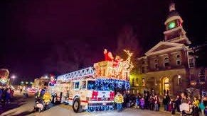 Hillsdale City's tower truck lit up downtown Hillsdale during the 2017 Light Up Parade.