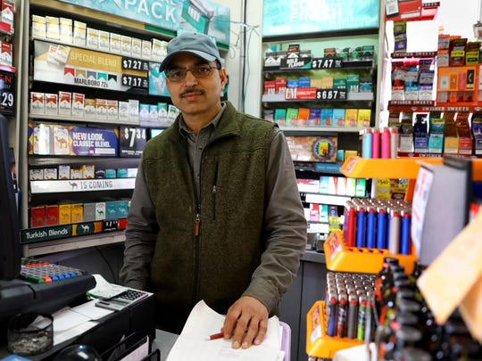Mirza Akhtar has owned the Food Pantry Citgo in Stoughton since 2006. The store has been the source of a number of big lottery-winning tickets over the years. The wall around the checkout is lined with pictures of past winners.