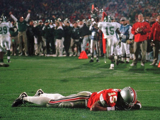 Ohio State's Dee Miller lies in the end zone after Michigan State's Renaldo Miller intercepted a fourth-down pass late in the fourth quarter to seal the Spartans' 28-24 upset of the No. 1 Buckeyes  on Nov. 7, 1998.