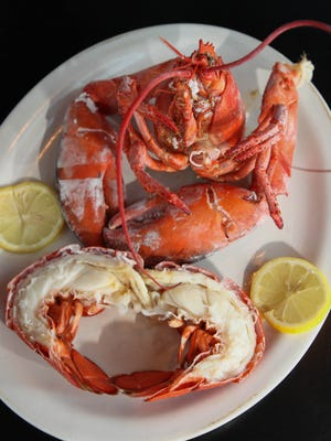 Steamed lobster served at Vinnie's Clam Bar, located on Somerset Street in  Raritan, NJ, June 1, 2015.  Mary Iuvone/For The Courier News