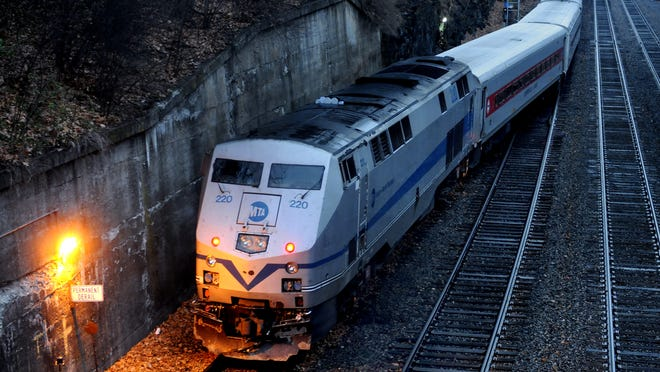 A Metro-North commuter train sits idle Monday morning just south of the Poughkeepsie train station.