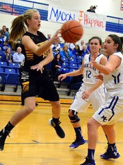 Hendersonville High sophomore Brooke Long saves a ball