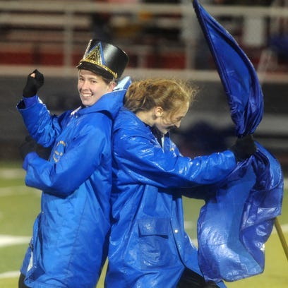 The Maysville High School marching band performs at