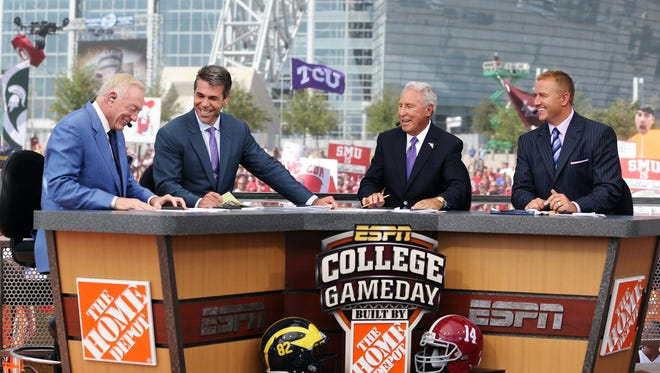 Chris Fowler (second to left) and Kirk Herbstreit (far right) enthusiastically support the four-team playoff system.