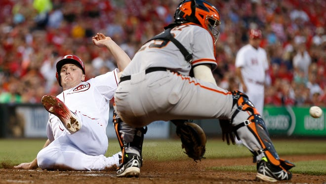 Reds right fielder Jay Bruce scores in front of Giants catcher Hector Sanchez during Tuesday's 8-3 win at GABP.