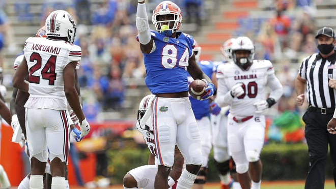 Florida tight end Kyle Pits (84) signals a first down after making a catch against South Carolina during an NCAA college football game in Gainesville, Fla., Saturday, Oct. 3, 2020.