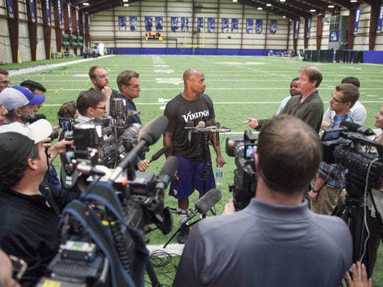 Minnesota Vikings running back Adrian Peterson talks with reporters after Wednesday's practice in Eden Prairie.