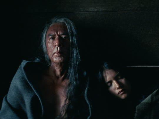 "Wes Studi and Q'orianka Kilcher in a scene from ""Hostiles."""