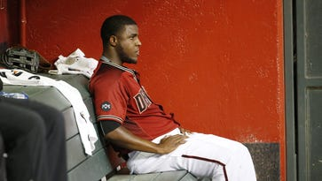 Diamondbacks starting pitcher Rubby De La Rosa sits on the bench after being taken out in the second inning against the Colorado Rockies at Chase Field on Sept. 14, 2016.