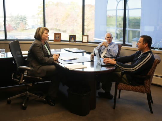 Partner Judy Wright, 50, of Novi holds a meeting in her office with Principal Marvin Sauer, 55, of Ann Arbor and Senior Manager Craig Zampa, 45, of Brighton at Plante Moran, an accounting and tax firm, in Southfield.