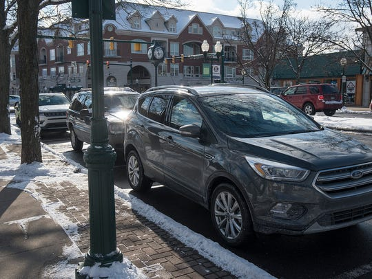 Motorists now park for free on downtown Plymouth streets,