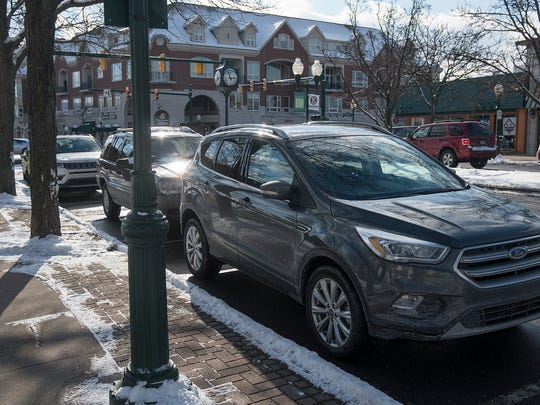 Motorists now park for free on downtown Plymouth streets, which last had paid parking in the 1980s.
