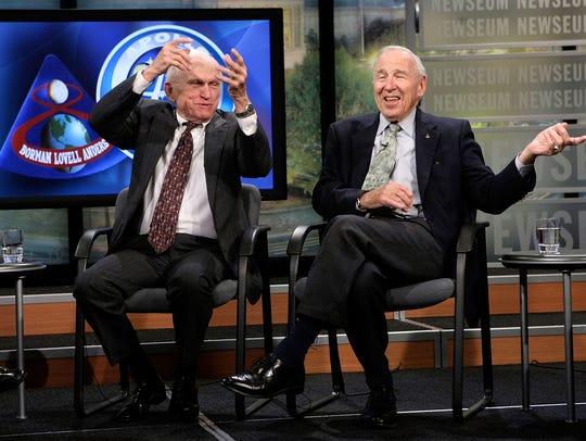 Apollo 8 crew members Frank Borman (left) and James