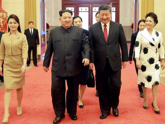 China's President Xi Jinping and his wife Peng Liyuan,