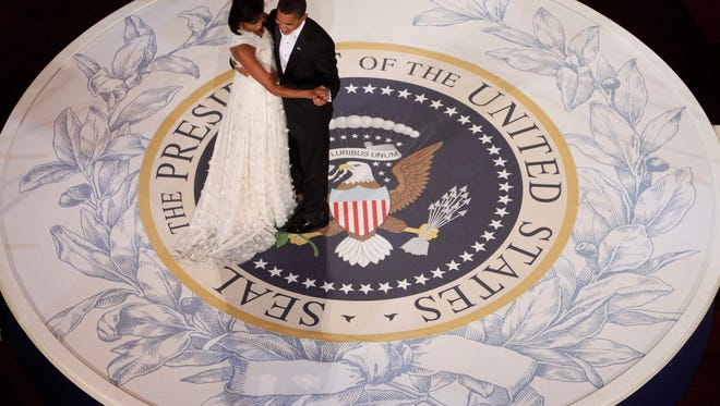President Barack Obama and first lady Michelle Obama dance at the Commander in Chief Inaugural Ball at the National Building Museum in Washington, Tuesday, Jan. 20, 2009. (AP Photo/Charles Dharapak)