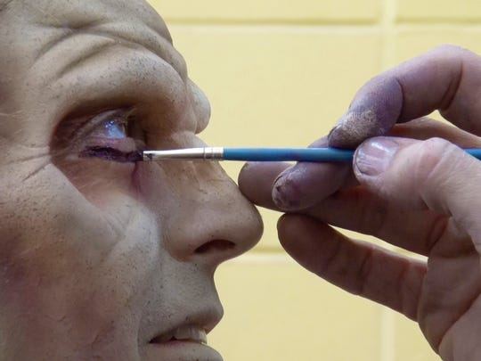 Makeup Effects Supervisor Tony Mandile works on  Jerry Carino's eye detail as her prepares to work as a Zombie at Six Flag Great Adventure's Fright Fest in Jackson Township on October 17, 2015.