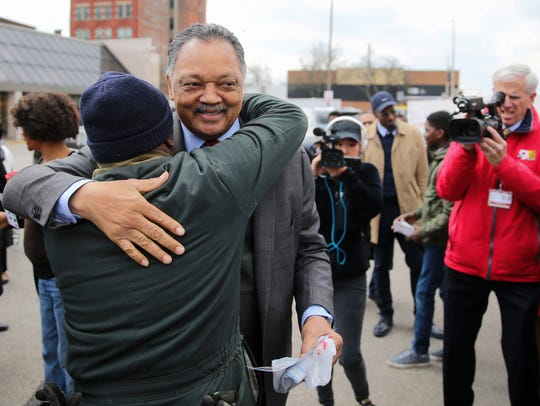The Rev. Jesse Jackson greets a supporter before delivering