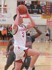 Ashland's Garrett Denbow drives to the basket for two