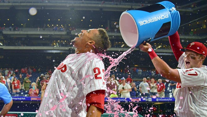Philadelphia Phillies right fielder Aaron Altherr (23) is doused with Powerade by left fielder Rhys Hoskins (17) after hitting a two RBI walk off double during the tenth inning against the St. Louis Cardinals at Citizens Bank Park. Mandatory Credit: Eric Hartline-USA TODAY Sports