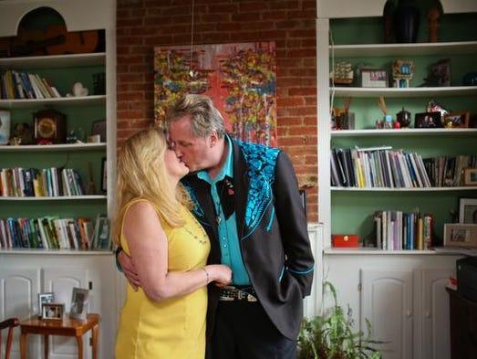 Irene Gagne, left, and John Gilderbloom inside the front sitting room of their Highlands residence. April 11, 2014
