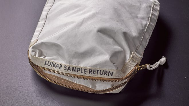 This bag was used by Neil Armstrong on Apollo 11 to bring back the very first pieces of the moon ever collected – traces of which remain in the bag.