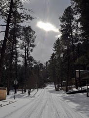 The sun peeks through the clouds after Ruidoso receives