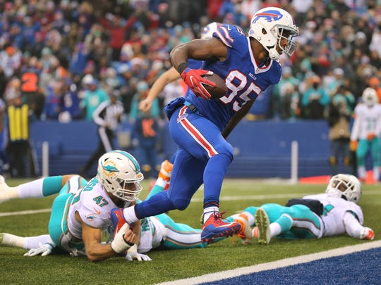 Bills tight end Charles Clay scores on this 18 pass play .  Clay caught 8 passes for 85 yards and 2 touchdowns.