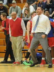 First-year Cooper coach Bryan Conover, right, reacts as Myller Royals scores the Cougars final basket in the victory over Plainview. Cooper won the Region I-5A bi-district playoff game 74-67 on Tuesday, Feb. 21, 2017 in Lamesa.