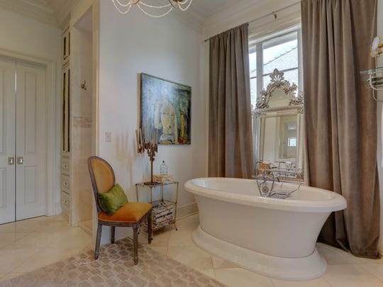 The master bath is fit for a king or queen.