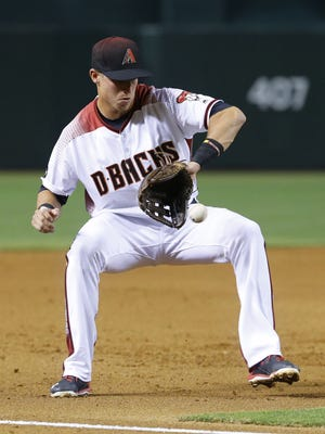Arizona Diamondbacks third baseman Jake Lamb fields a ground ball during the second inning of a game Monday, June 27, 2016, in Phoenix.