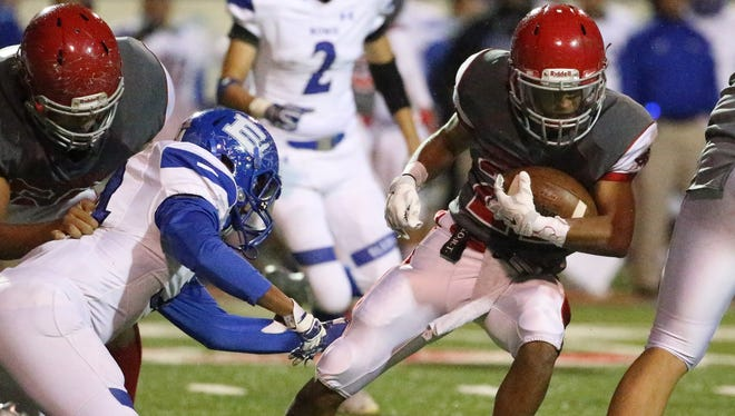 Jefferson's Jose Rubio, 21, carries the ball against Bowie Thursday night in the Sun Bowl.
