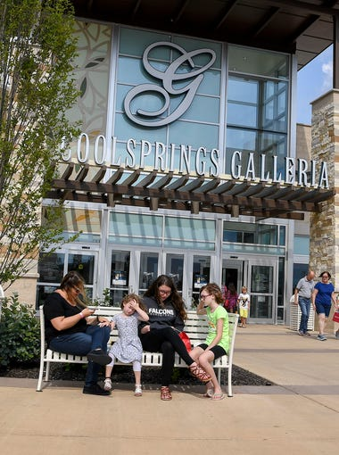 Customers rest after shopping at the Cool Springs Galleria in Franklin, Tenn.