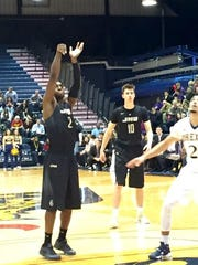 Ron Curry shooting a free throw for James Madison in