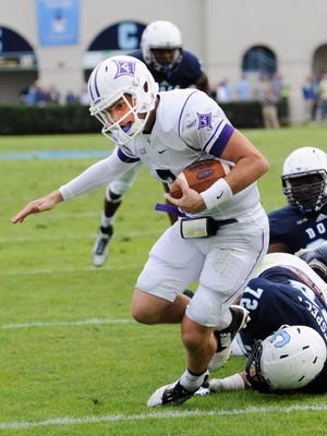 Furman quarterback P.J. Blazejowski (7) hits the end zone against The Citadel.