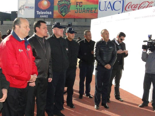 Chihuahua Gov. César Duarte, from left, Mexico's Secretary of the Interior Miguel Ángel Osorio Chong and Vatican Security Chief Domenico Giani on Wednesday review security measures that will be in place at the old Juarez fairgrounds and Benito Juarez Olympic Stadium. Members of the Papal Swiss Guard and Mexican federal, state and local officials accompanied them.