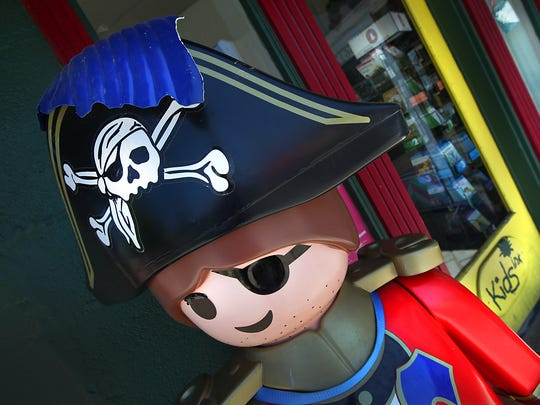 A happy pirate greets you at the main entrance of KIDS INK bookstore for the younger reader.