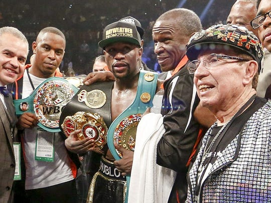 Floyd Mayweather Jr. poses with his World Boxing Council,