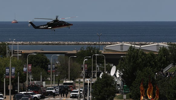 A helicopter carrying Donald Trump lands at the Great