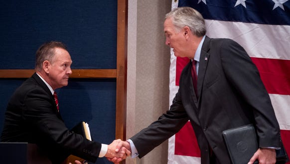 Roy Moore and Luther Strange shake hands after debating